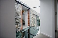 The use of the glass floor mezzanine level in the church not only poured more light into the property, it also created a 'sky lounge' for Neil & Jackie. Here's another example of how a glass floor can make the most of the use of light in a property Church Conversions, Barn Renovation, Glass Floor, Glass Walls, Stone Barns, Floor Design, Ruin, Interior And Exterior, Interior Design