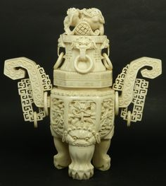 CHINESE CARVED IVORY TRIPOD DRAGONS URN