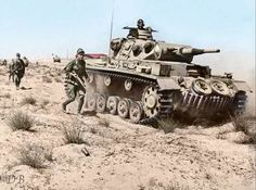 A Panzer III of the Deutches Afrika Korps (DAK) rolls through the desert with armored infantry supporting it, battle of North Africa, Egypt, 1942. When this photo was photographed the North African campaign was at the height of its time and Rommel and his DAK were in Egypt on their way to the vital Suez Canal. Pin by Paolo Marzioli