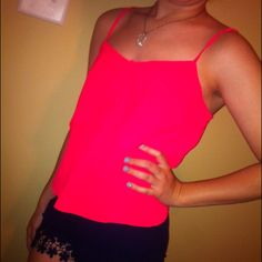 Hot Pink Top Confidence Booster!! Anyone can feel great in this cute tank. Adjustable straps, and slimming layers make for the perfect go-to for a night out. Minor tearing at center of v in the neck (see fraying in pic 2) not too noticeable & probably fixable. Teeny tiny hole in front (can post pics) very unnoticeable. Other than that, it's in amazing condition. Very cute & ready to make you look and feel your best!! American Eagle Outfitters Tops Tank Tops