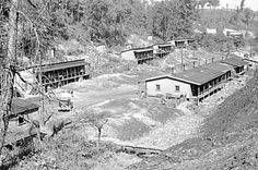 A pictorial history of Appalacian life during the great depression. West Virginia coal miners lived in slum like conditions, often called a shanty. Monongalia County - Nears Scotts Run in Cassville, WV. 1935.