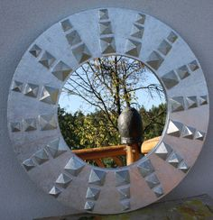 Mirror made entirely of wooden blocks, presumably silvered. Dimensions unknown. By Teodor Kamiński.