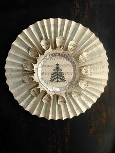 Vintage paper Christmas tree wreath with sheet music - would be lovely as a book page Christmas ornament too. Christmas Paper Crafts, Christmas Tree Wreath, Noel Christmas, Handmade Christmas, Vintage Christmas, Christmas Decorations, Christmas Ornaments, Xmas, Music Ornaments