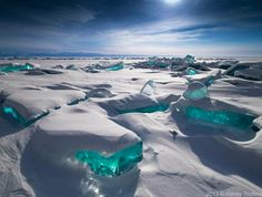 """Turquoise Ice in Northern Lake Baikal, Russia!  This ice looks almost exactly like the chunks of """"ice"""" from my sons- Playmobil Arctic Explorer kit, but it's real!"""
