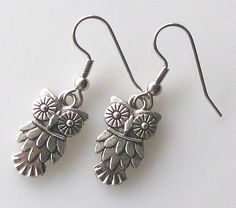 owl earrings, owl jewelry accessories, surgical steel earrings for sensitive ears dangle earrings. $13.00, via Etsy.