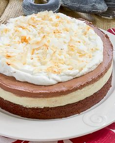 Coconut Brownie Cake | An exquisite layered dessert for coconut lovers! @lizzydo