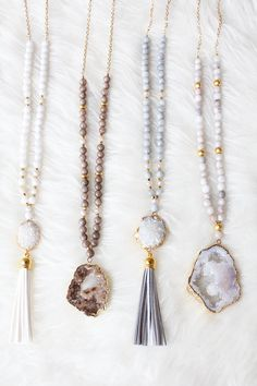 Long beaded gemstone necklace with druzy and tassel on gold chain. Necklace length is 30. Items are listed from left to right: A - White druzy tassel necklace B - Taupe druzy necklace C - Grey druzy tassel necklace D - White druzy necklace Please note due to the natural nature of materials, there may be a slight variation in stone markings and coloration, making them each uniquely beautiful.