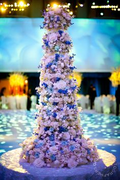 A multi-tiered floral extravaganza by Sylvia Weinstock is the perfect wedding cake for a wedding at The Waldorf Astoria NYC.