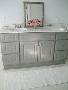 Girls Bathroom: Gray vanity, silver accents with a pop of pink