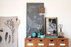 I have a new blackboard to play with in the studio.  I used a leftover floor tile we had from the new tv room & painted it  with homemade chalkboard paint: 1 cup of black (or color of your choice) paint  plus 2 tablespoons of un-sanded tile grout. Recipe from here.