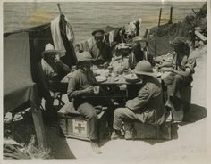 Photograph of Imen of 1/1 East Lancashire Territorial Force Field Ambulance, Royal Army Medical Corps, having a meal. No 2740. From a collection of official photographs of the Dardanelles Expedition, 1915-1916.