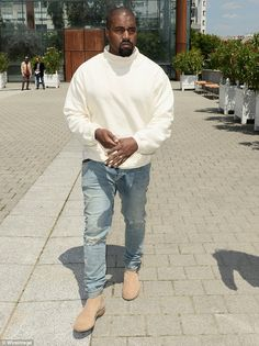Doing the rounds: Kanye West made sure he stopped by in Paris to attend the Louis Vuitton Menswear SS16 Menswear fashion show on Thursday