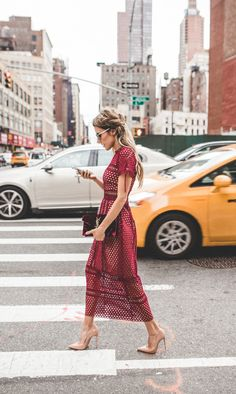 Burgundy dress, sunnies, nude heeled pumps, burgundy YSL velvet clutch with gold detail, loose chunky braids + messy beach hair- a fashion + street style moment. | @andwhatelse