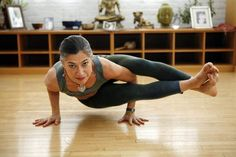 Moksha yoga, Lani Granum holds ashtavakrasana at the Moksha Riverwest yoga studio, who says, if you're strong in your core, you're strong in yourself and strong in your place in this world.