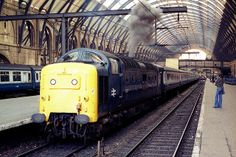 """55017 (D9017) """"THE DURHAM LIGHT INFANTRY"""" restarts an engine at King's Cross on the 1st August 1981 prior to departure with the 1L45 18:05 service for York. Electric Locomotive, Diesel Locomotive, Steam Locomotive, Disused Stations, Electric Train, British Rail, London Transport, World Pictures, Old London"""