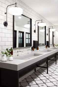 The in a restaurant should never be overlooked; we love how this one at Magnolia Table makes an impact by committing to a black & white theme and incorporating the versatile design of our Eastmoreland swing arm sconce. Design and photo via Industrial Bathroom Design, Bathroom Interior Design, Modern Bathroom, Small Bathroom, Office Bathroom, Bathroom Marble, Master Bathroom, Budget Bathroom, Washroom