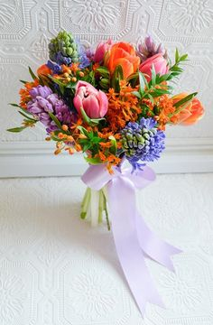 cd flowers by janie ca hostess gift; a spring posy of hyacinth, tulips, asclepias and mini myrtle