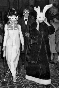 """Jacqueline de Ribes (in vinyl Courreges Haute Couture ensemble) and Candace Bergen (in Halston bunny mass, dress, and coat) at Capote's 1966 Black & White Ball. #OTD  As the guest list finally took shape, Capote quipped nonchalantly; """"I've made 500 friends and 15,000 enemies."""""""