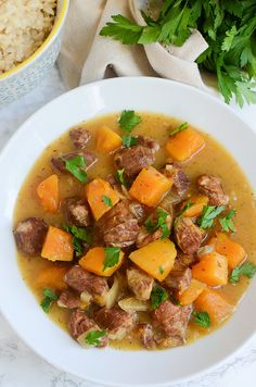 Slow Cooker Pork and Butternut Squash Stew - a bowl of comfort! Quickly brown the pork and then toss everything in the slow cooker! #SmithfieldCares AD @walmart