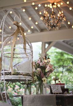 Bird cage for guests to put congratulatory cards in. Buy a shepherd hook from Home Depot and hang cage from hook.