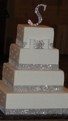 Wedding Cakes with Bling | cake banding gumpaste bow gemstone brooch and monogram cake topper ...