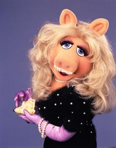 Miss Piggy's photo. Miss Piggy loves to have her cke and eat it, too. Jim Henson, Miss Piggy Muppets, Bambi Disney, Pepe Le Pew, Famous Cartoons, Cartoon Characters, Fictional Characters, Kermit, Betty Boop