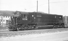"""Pennsylvania Railroad C630 number 6316. The 3,000 horsepower """"Century"""" diesel-electric was built by the American Locomotive Company in 1966, and was one of the last locomotives delivered before the Penn Central merger. Number 6316 is on her first revenue trip, and was photographed at Pitcairn, Pennsylvania on October 2, 1966. Pennsylvania Railroad, October 2, Locomotive, Trains, Diesel, Electric, Number, American, Building"""