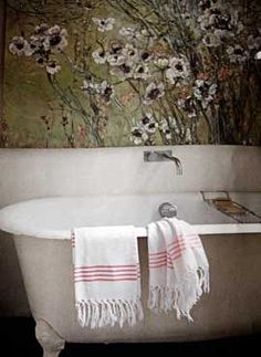 painting/ mural of flowers over bath by Claire Basler