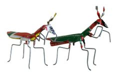 Old oil cans have been recycled and carefully made into these life sized tiny praying mantis. In many poor countries around the world selling crafts is the only income that some can generate. As new materials are too expensive some of the most ingenious uses of recycled materials come from these resourceful craftspeople.These brilliant little recycled insects are made in Sth Africa