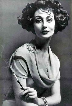 Givenchy.British Vogue,May 1957.