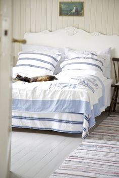 Stripe bed linens, nautical chic and shabby coastal decor in a white bedroom - love clean crisp beach cottage beachy decor x