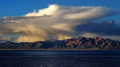 Overlooking Lake Manasarovar and the Kailash Mt Range, with sweeping rain clouds in Tibet.
