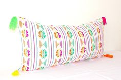 Super cute and colorful pillow cover in white Blue colorful stripes and Tassels! This embroidered pillow cover features a colorful tribal pattern. Details: *14x28 *Pattern is one side, natural colored cotton back. *Invisible zipper closure  **All items are sent via registered mail with a USPS tracking number. Thanks!  *Please note that this is a pillow cover only. Pillow inserts can be found at most craft stores  Great Banners For your Next Fiesta!!! https://www.etsy.com/listin...