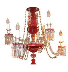 """Ruby red and clear glass chandelier features two levels of candle arms and six total lights.  Possibly by Osler. CIRCA: 19th Century DIMENSIONS: 33"""" h x 36"""" d"""