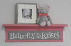 "Pink and Gray Nursery Shelves - Butterfly Kisses - Sign on 24"" Pink Shelf - Grey Baby Girl Nursery Wall Decor / Room Decor. $45.00, via Etsy."