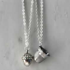 Peter Pan & Wendy Kiss Thimble and Acorn Necklace Set Silver - Men - Women - Sweetheart - Lover - Sister - Best Friend (2 Necklaces). $45.00, via Etsy.