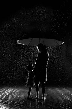 BW ... mom w child in rain