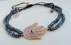 Rose gold hamsa hand charm with navy beads by NokoDesigns