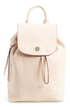 Clean lines and lightly textured leather underscore the modern sophistication of this perfectly poised drawstring backpack accented with a polished Tory Burch medallion.