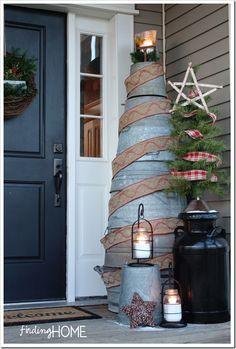 love the unexpected tree made with galvanized buckets - beautiful home - you'll want to pin this one!