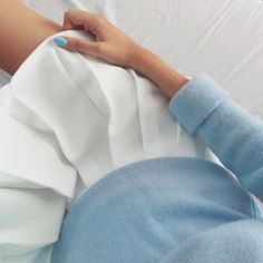 Pleated white tennis skirt + baby blue sweater and nail polish