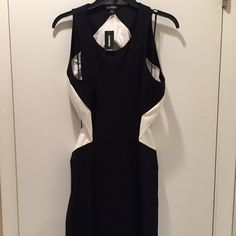 Express Color Block Open Back Midi Dress Black and white bodycon dress with cutout back. New with tags-lost the receipt and did not return it. Perfect condition! Express Dresses Midi