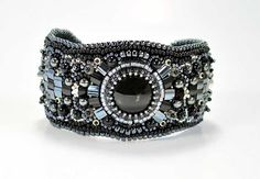 """Chic and trendy bead embroidered bracelet """"Tornado"""" with Onyx cabochon, Hematite and black Jade beads, Swarovski beads, and Japanese seed beads. Perfect for a Gothic party or for casual look. Cuff bra"""