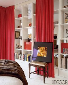 bedrooms - bedroom, elle decor, red, silk, drapes, bookshelves,  Small space bedroom divider from Elle Decor