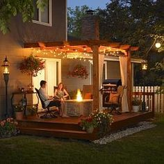 lights under pergola; river rock in bed next to deck (low maintenance)