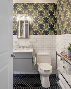 bathroom with pineapple wallpaper