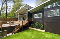 love this Black cladding with white windows. Jesse finds the deck a disjointed after thought. It's the only black house I seem to have pinned with a skillion roof White Exterior Houses, Exterior House Colors, Exterior Design, Black Exterior, Exterior Paint, Brown House, Black House, Charcoal House, Black Cladding