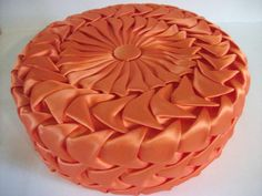Vintage Orange Satin Pleated Pillow by RicsRelics on Etsy https://www.etsy.com/listing/98834512/vintage-orange-satin-pleated-pillow