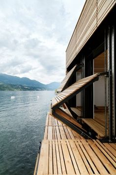 nonconcept:  Folding wooden shutters on a luxury house next to a lake.  ~ Great pin! For Oahu architectural design visit http://ownerbuiltdesign.com