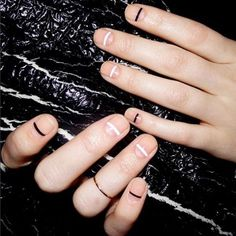 """18 Manicures To Copy, Stat! #refinery29 http://www.refinery29.com/negative-space-nails#slide-1 """"This is one of my all-time favorite designs — and it is one of the easiest nail looks to achieve. The key is having short, square-ish nails with a very clean base,"""" says Torello. """"Usually my go-to is Essie's BBF Best Boyfriend or <a href=""""http://www.target.com/p/essie-nail-color-made..."""
